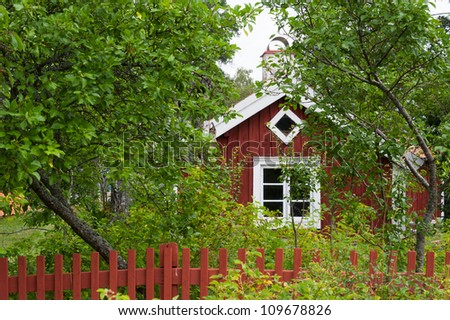 Old red wooden house in Timmernabben at the east coast of Sweden