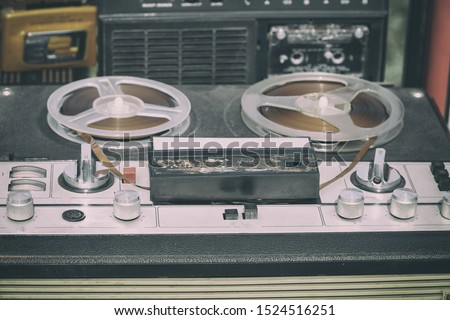 Old reel-to-reel tape recorder on the table #1524516251