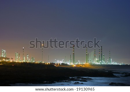 Old refinery near the sea by night