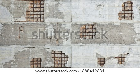 Old reinforced concrete structure with damaged and rusty metallic reinforcement. Stockfoto ©