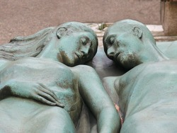 Old religious art at Cimitero Monumentale. Scene sculptured on a grave depicts young couple of lovers sleeping in a bed, holding their hands. Milan, Italy. More of this motif & more Milan in my port.