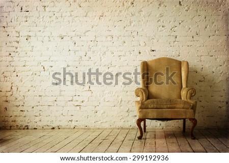 Old Retro Armchair against White Brick Wall Interior