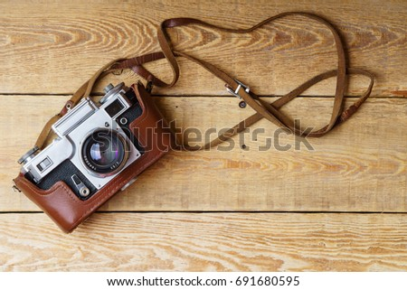 old retro camera on vintage...