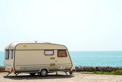 Old retro caravan staying on a beautiful sea coast