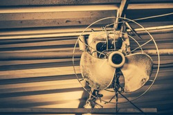 Old retro fan damaged in vintage style photo.