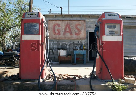 Old retro gas pumps in the rural landscape