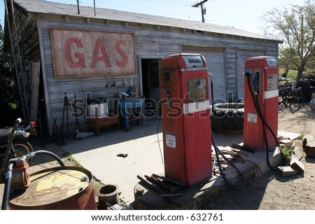 Old retro gas pumps in the rural landscape - stock photo
