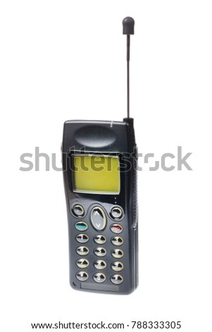 Old retro mobile phone with antenna isolated on white background.