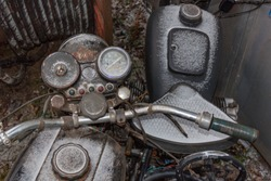 Old retro motorbikes covered with rust and snow