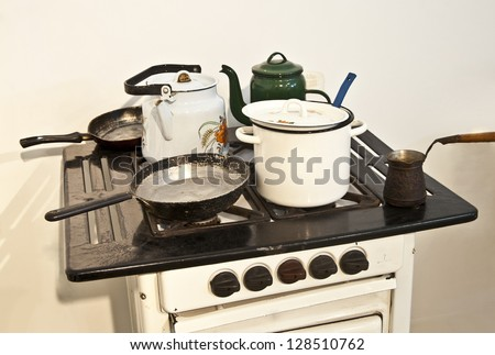 old retro stove with a frying pan and coffee maker
