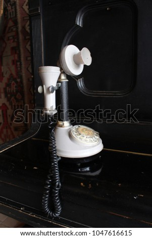 Old retro telephone on wood table. Antiquary. Retro style. Nostalgia #1047616615