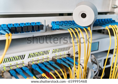 old retro telephone receiver on wires in internet hub, close-up #659995468