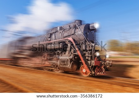 Old retro train with steam locomotive moves fast.
