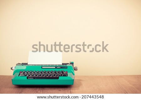Old retro typewriter on wooden desk