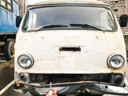 Old retro vintage hipster rusty oxidized metal round car minibus for hippies from the 60s, 70s, 80s, 90s, 2000s.