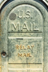Old retro vintage mailbox box in green color with sign for relay mail vertical view closeup macro in St Augustine