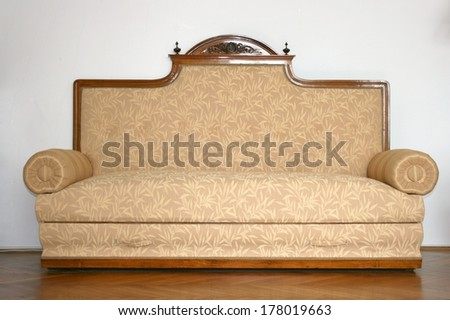 Old retro vintage sofa in a living room