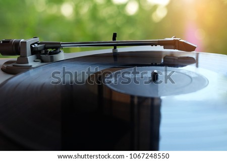 Old retro Vinyl record player.turntable with blurred bokeh background #1067248550