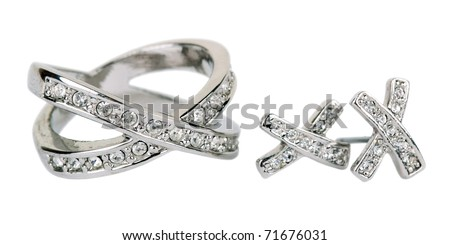 Old ring from white gold and an earring with jewels isolated on a white background