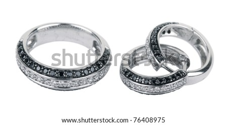 Old ring from white gold and an earring with jewels, isolated on a white background