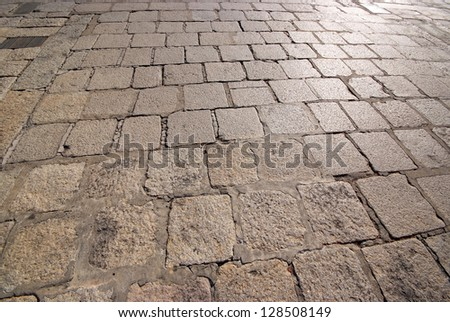 Old road paved with the cobble stones #128508149