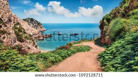 Old road to Agia eleni beach. Colorful morning seascape of Mediterranean Sea. Bright outdoor scene of Cephalonia island, Greece, Europe. Traveling on Ionian Islands.
