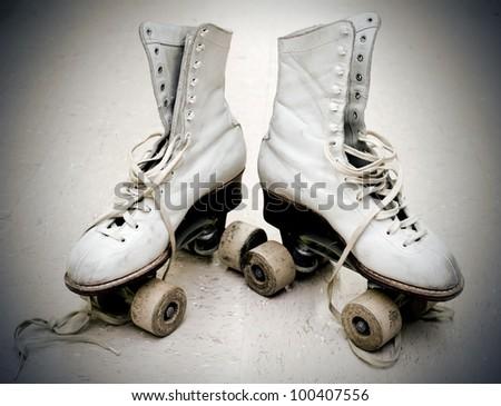 Old roller skates in vintage light