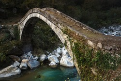 Old Roman bridge in Italian mountains