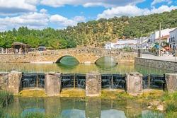 Old Roman bridge in the town of San Nicolas del Puerto, Seville. Andalusia, Spain