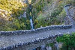 Old roman bridge over Bellos river in Añisclo Gorge, Ordesa and Monte Perdido National Park, Huesca province, Spain