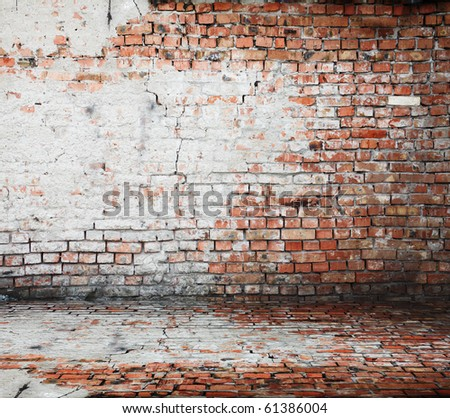 old room with a brick wall and floor