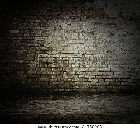 old room with a brick wall and floor - stock photo
