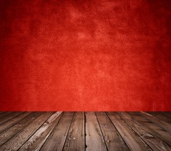 old room with concrete wall and wooden floor, red background