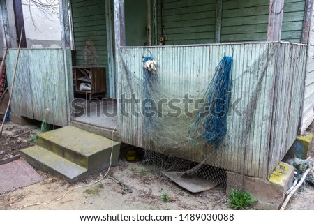 Old rope fishing net is dried outdoors. A vent or top is a fishing net for fishing. Fishnet