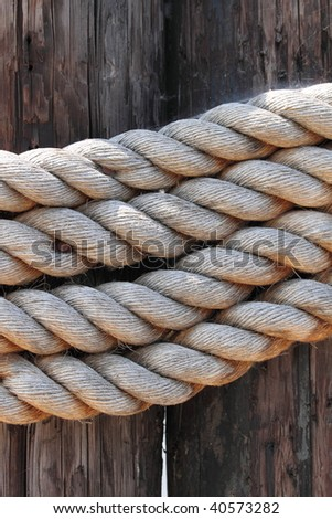 old rope to tied a sail boat to the pier