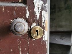 Old rotting door in dilapidated building