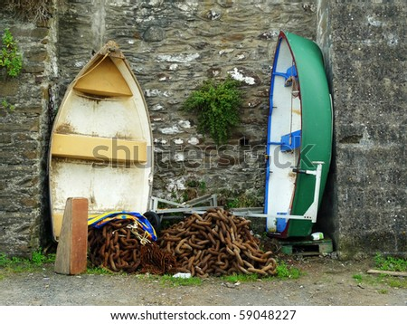 Old row boats - stored against old stone wall