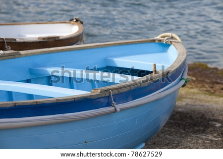 Old rowboat docked on an island