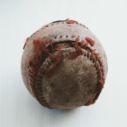 Old rugged baseball in selective focus close up for sport ball.
