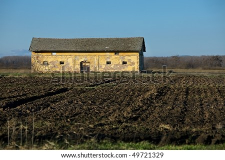 Old ruined building on an agricultural field
