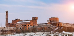 Old ruined factory construction in winter time. Urban exploration photography