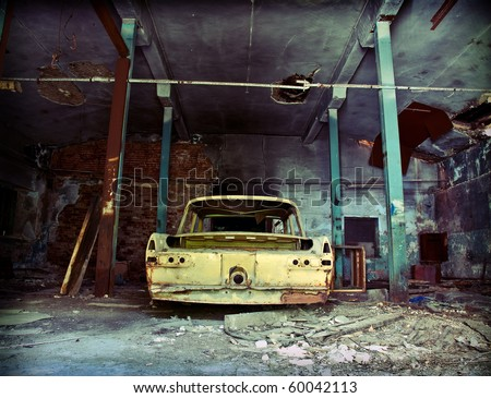 old ruined garage interior with old car stock photo 60042113 shutterstock. Black Bedroom Furniture Sets. Home Design Ideas