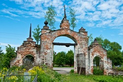 Old ruined gate of a Temple complex in the village of Gorica/ Orthodox wooden cross/ Orthodox cemetery/ Summer Landscape/ Shuisky district/ Ivanovo region/ Russia/ Golden Ring of Russia Travel.