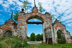 Old ruined gate of a Temple complex in the village of Gorica/ Orthodox wooden cross/ Summer Landscape/ Shuisky district/ Ivanovo region/ Russia/ Golden Ring of Russia Travel.