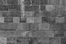 Old ruined historic protect wall. Shabby bumpy built front facade citadel. Worn damaged deserted partition of church courtyard.Black spots on chipped stone mansion backyard. Grungy big barrier for 3d