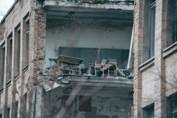 Old ruined house in Pripyat in Chernobyl. Translation: