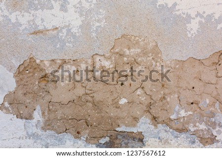 Old Ruined Wall Facade With Fallen Cement And Bricks #1237567612