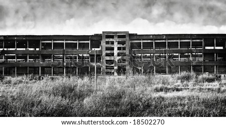 Old ruinous factory panorama. Black and white horror concept.