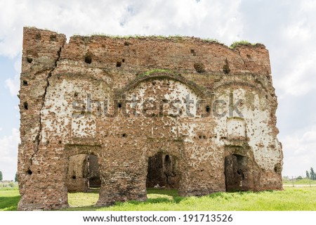 Old Ruins Of Chiajna Monastery In Romania. Built in 1792 Chiajna Monastery is a ruined church on the outskirts of Bucharest which is the subject of many legends including the story that it is cursed.