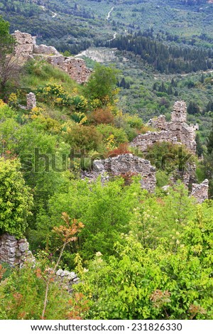 Old ruins of the Byzantine city of Mystras scattered on the hill side, Greece